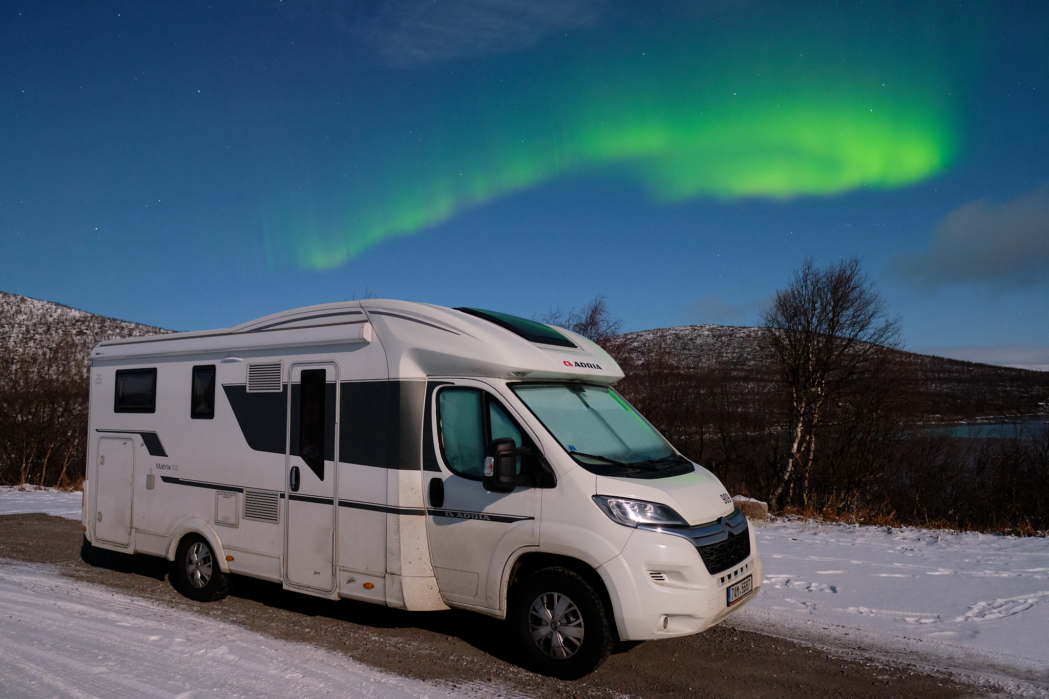 Camper under the aurora borealis